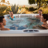 When do I need to empty my hot tub?